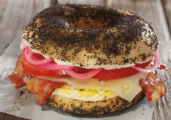 Fish is swimming onto the Bruegger's Bagel's breakfast menu with the introduction of the new Back Bay Egg Sandwich. Served on a poppy seed bagel, the breakfast sandwich features egg, bacon, Swiss cheese, tomato, pickled red onions, and smoked salmon cream cheese. The Back Bay Egg Sandwich is available through Sept. 15.
