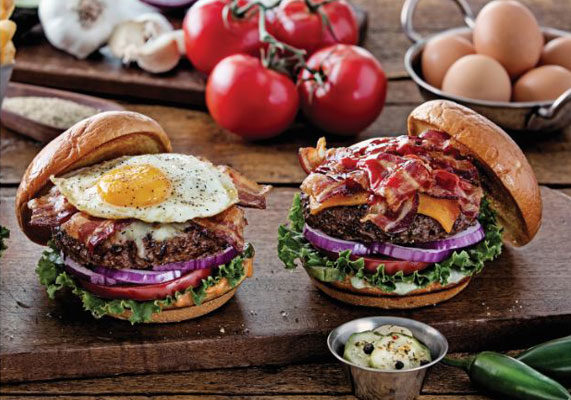 """Chili's  is touting its transparency goals with its new Sunrise Burger and Ultimate Bacon Burger, both available with the option of a 100% grass-fed patty free of antibiotics or added hormones. The Sunrise Burger features a cage-free egg, pepper Jack cheese, applewood-smoked bacon, lettuce, red onion, tomato and Chili's signature sauce. The Ultimate Bacon Burger is stacked with a double portion of applewood-smoked bacon, cheddar cheese, jalapeño aioli, spicy buffalo sauce, pickled, lettuce, red onion, tomato and honey-chipotle sauce.  """"We know now more than ever, guests want to know what's going into their food and desire natural ingredients,"""" said Krista Gibson, chief marketing officer for Chili's. """"We have differentiated our craft burgers with quality and transparent ingredients by offering grass-fed patties and sourcing cage-free eggs. As we continue our food transparency journey, we plan to invest in our core menu categories to offer guests more options."""" (1 of 9)"""