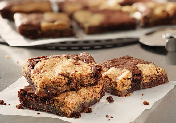 Domino's Pizza is debuting a new dynamic duo: the Marbled Cookie Brownie. Combining milk chocolate chunk cookies and fudge brownies, this dessert is cut intonine shareable pieces. (1 of 12)