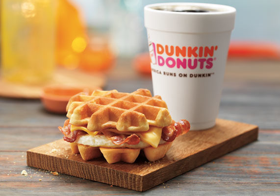 """Dunkin' Donuts is combining two favorite morning meals with its new Belgian Waffle Breakfast Sandwich. The handheld features Cherrywood smoked bacon, egg and American cheese served between two Belgian waffles.  """"Belgian waffles are a beloved breakfast choice, and one that is typically saved for a sit-down meal,"""" said Jeff Miller, executive chef and vice-president of product innovation for Dunkin' Brands. """"With our new Belgian Waffle Breakfast Sandwich, we are able to make the taste of this traditional favorite available on-the-go, any time of day for our guests who look to Dunkin' Donuts for a variety of new and innovative breakfast options."""" (1 of 13)"""