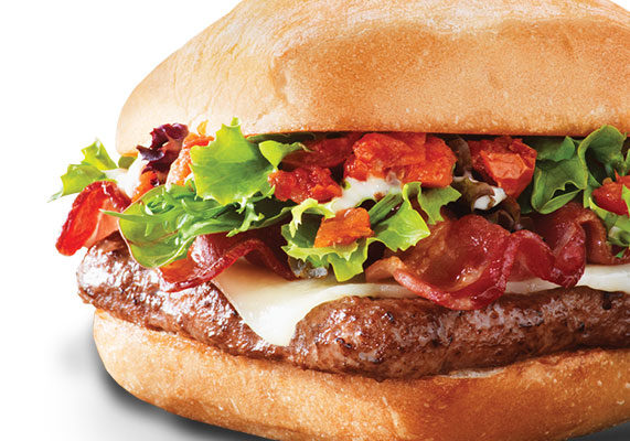 A toasted ciabatta bun sandwiches a 1/4-lb beef patty topped with roasted and chopped tomatoes, a rosemary garlic aioli, spring mix, asiago cheese and applewood-smoked bacon.