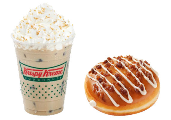 Krispy Kreme is taking the idea of coffee and donuts to a whole other level by combining the two into one. The chain's new Salted Caramel Latte Donut consists of a yeast shell stuffed with an espresso flavored Kreme filling topped with salted caramel icing, a salted sugar blend and an espresso icing drizzle. The chain also is introducing a Salted Caramel Latte, which consists of a caramel latte topped with whipped cream and a blend of salt and amber sugar. The new items are available through Nov. 26. (1 of 11)