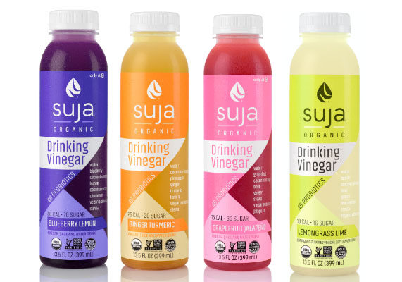 Suja Juice is introducing a line of organic drinking vinegars featuring vegan probiotics with 1 to 6 grams of sugar and 10 to 40 calories per serving. The beverages combine fermented coconut vinegar with cold-pressed fruits and vegetables and stevia.Varieties include ginger turmeric, lemongrass lime, blueberry lemon and grapefruit jalapeño. (1 of 12)