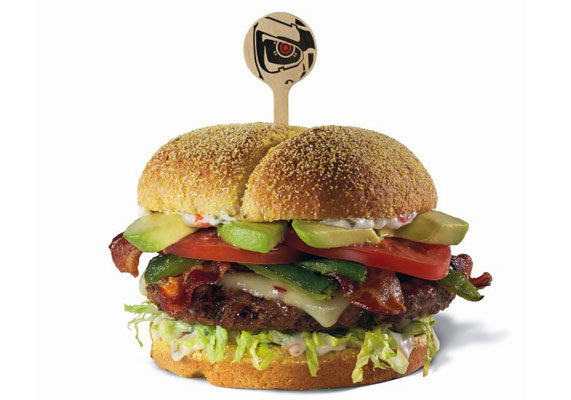 """Inspired by the movie """"Terminator Genisys,"""" Red Robin is introducing the Genisys Burger. Served on a jalapeño-cornmeal bun, the sandwich features a beef patty topped with roasted jalapeño, pepper-jack cheese, shredded romaine, bacon, tomatoes, and jalapeño aioli."""