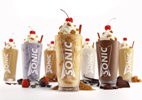 """Sonic Drive-In is serving a new line of shakes featuring sophisticated flavors and premium ingredients. The chain's Creamery Shakes are available in six varieties: vanilla bean, buttered toffee, dark chocolate, bourbon brown sugar, dulce de leche, and wildberry and lavender. The shakes are mixed with ingredients like Madagascar vanilla beans, oak barrel aged bourbon flavor, California strawberries and lavender.  """"Food tastes better when it's crafted with premium, sophisticated flavors, and our culinary experts worked to find the perfect ingredients for Sonic's new handcrafted Creamery Shakes,"""" said Scott Uehlein, vice-president of product innovation and development for Sonic. """"With one of a kind flavors like bourbon brown sugar and wildberry and lavender, guests will enjoy a new level of indulgence with every sip of one of these flavorful Shakes."""" (1 of 10)"""