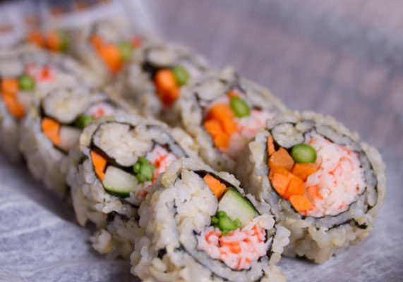 """Some people may think sushi always contains cold fish, but that is not the case at Fusian, a fast-casual, build-your-own-sushi restaurant concept in Ohio. The literal translation of sushi is """"cooked vinegared rice,"""" said Teresa Perretta, vice-president of Fusian. The restaurant chain offers sushi with chicken or shrimp as well as vegetarian options. Fusian has had success as an a la carte item in schools in Ohio. When the U.S. Department of Agriculture initiated a """"Smart Snacks in School"""" regulation, Fusian hustled to incorporate whole grain brown rice into its a la carte school items. Fusian now offers five different rolls, all with whole grain brown rice, inside school cafeterias: California, shrimp tempura, half shrimp tempura/half California, roasted chicken on a soy wrap, and an all-vegetarian roll. Fusian serves its sushi to more than 3,000 students from kindergarten through high school in more than 40 schools. The company also has 10 restaurants located in the Ohio cities of Dayton, Cincinnati and Columbus. (1 of 8)"""