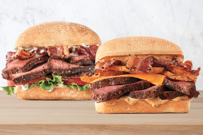 Arby's is adding to its slew of sandwiches with two new petite fillet steak varieties.  The Garlic Butter Steak Sandwich features thick-cut petite fillet steak, pepper bacon, lettuce, tomato and roasted garlic butter served on a toasted ciabatta roll.  The Steak & Bacon Melt Sandwich features thick-sliced petite fillet steak topped with melted cheddar cheese, pepper bacon, crispy onions and steakhouse ranch served on a ciabatta roll.