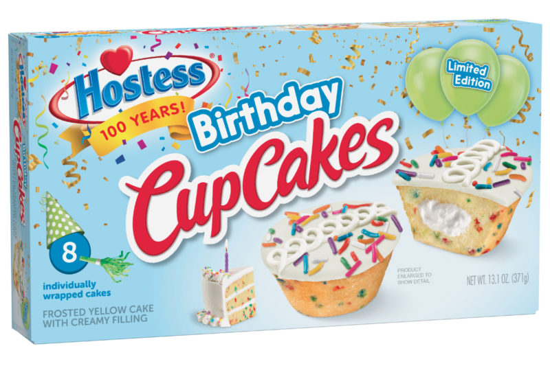 Hostess Brands, Inc. is celebrating its centennial milestone with new limited-edition Hostess Birthday CupCakes. The cupcakes feature golden cake with colorful rainbow sprinkles baked inside, a crème center, and vanilla icing with more rainbow sprinkles on top. The cupcakes also bear the Hostess icing squiggle.