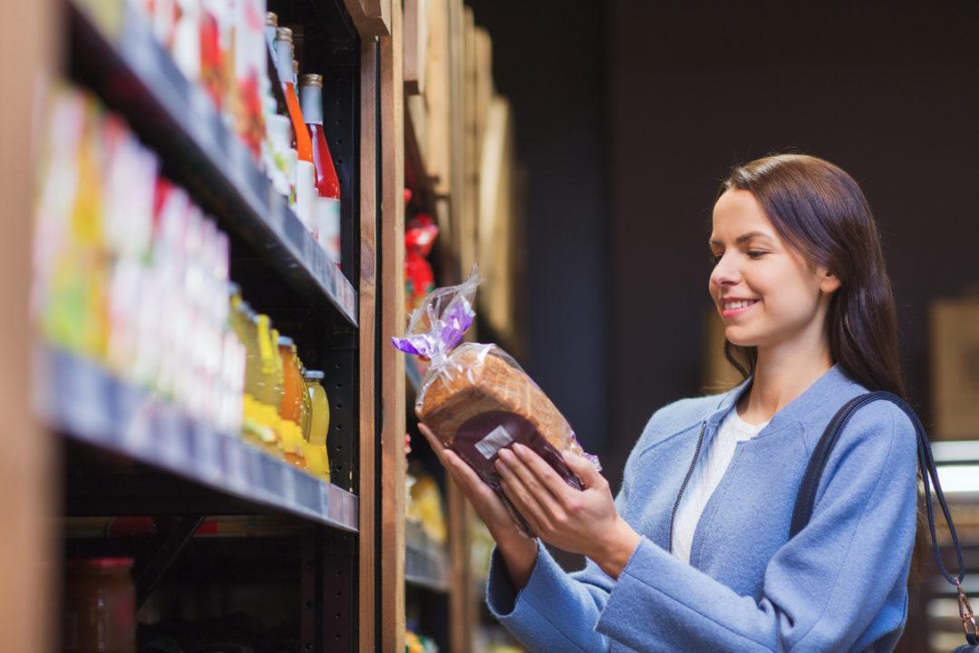 Woman reading bread label