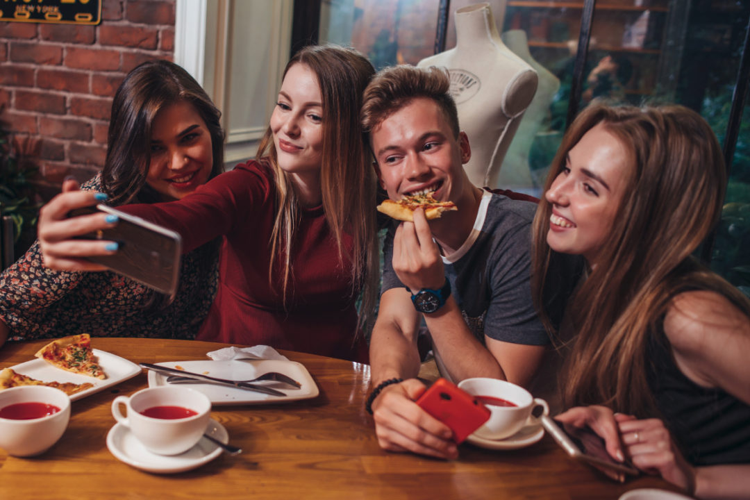 Gen Z consumers eating at a restaurant