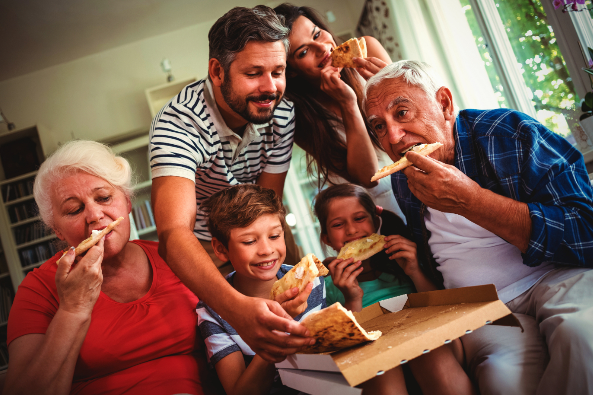 Different generations eating pizza