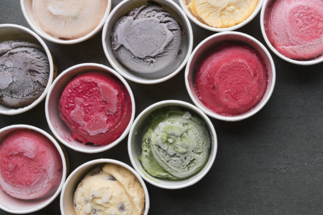 Tubs of ice cream in various flavors