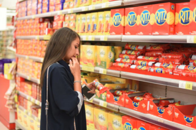 Woman shopping for Mondelez products