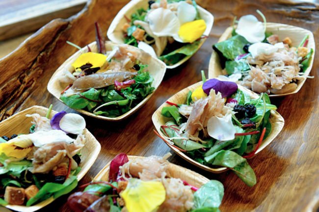 Roots of America rabbit confit foraged green salad with whiskey grain crumb and Madeira brown butter vinaigrette