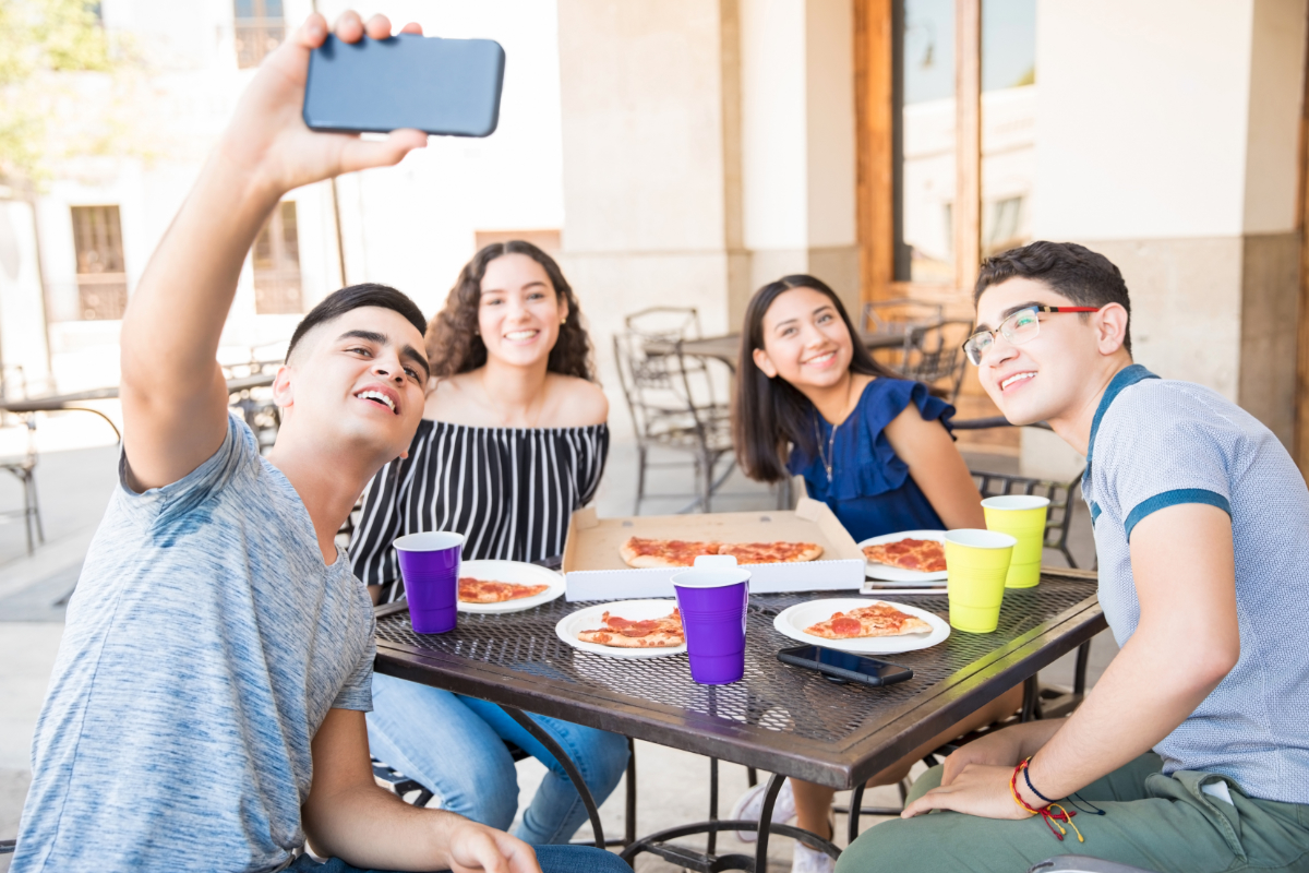 people taking selfie eating