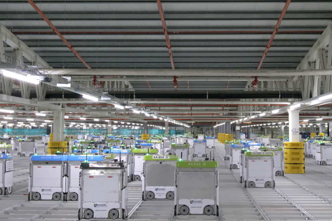 Robots at a Kroger, Ocado distribution center