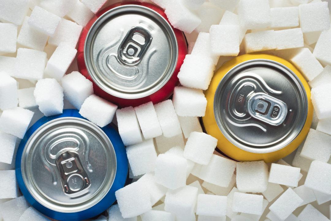 Soda cans in sugar