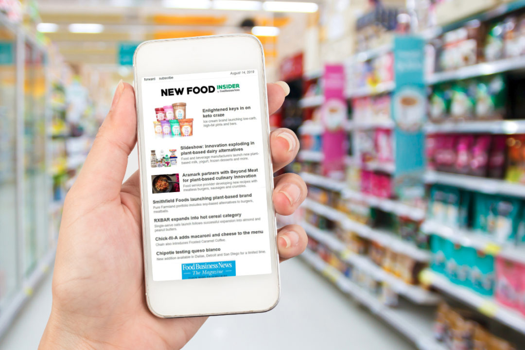 New Food Insider newsletter on phone in supermarket