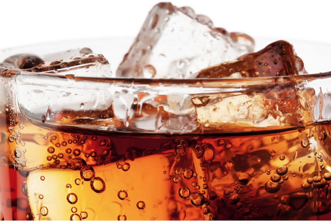 Brown cola with ice in a glass
