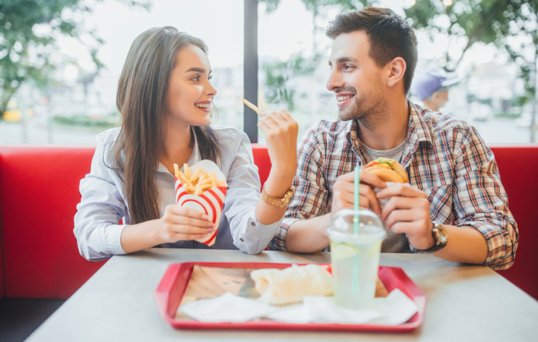Couple eating at fast-food restaurant