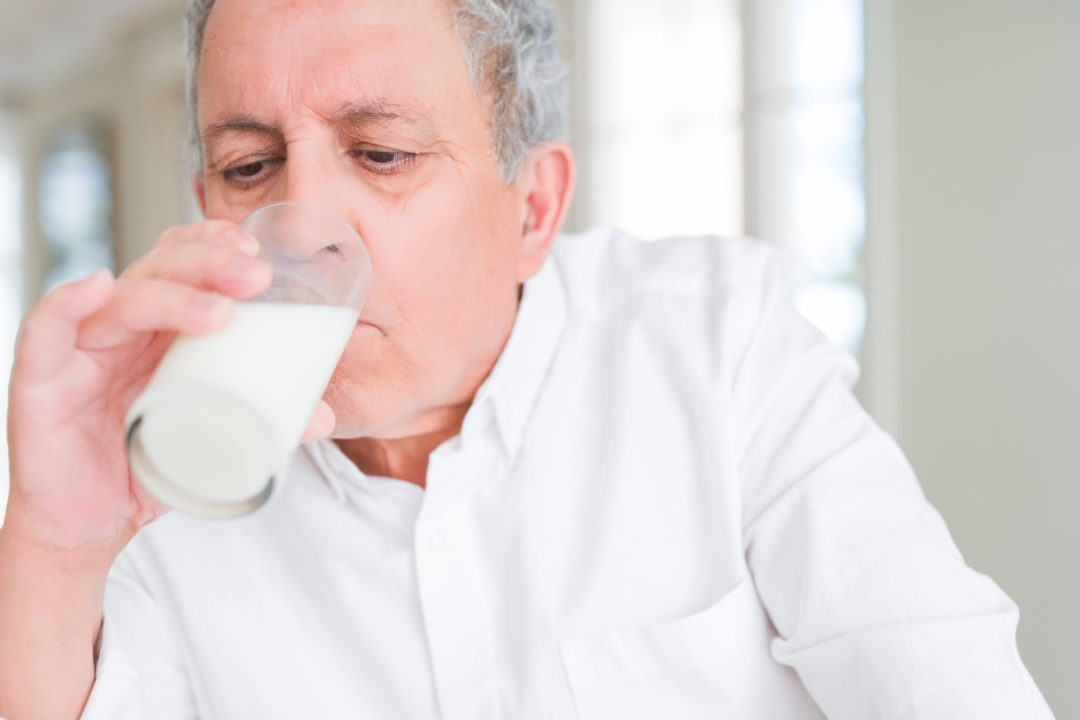 Old man drinking milk