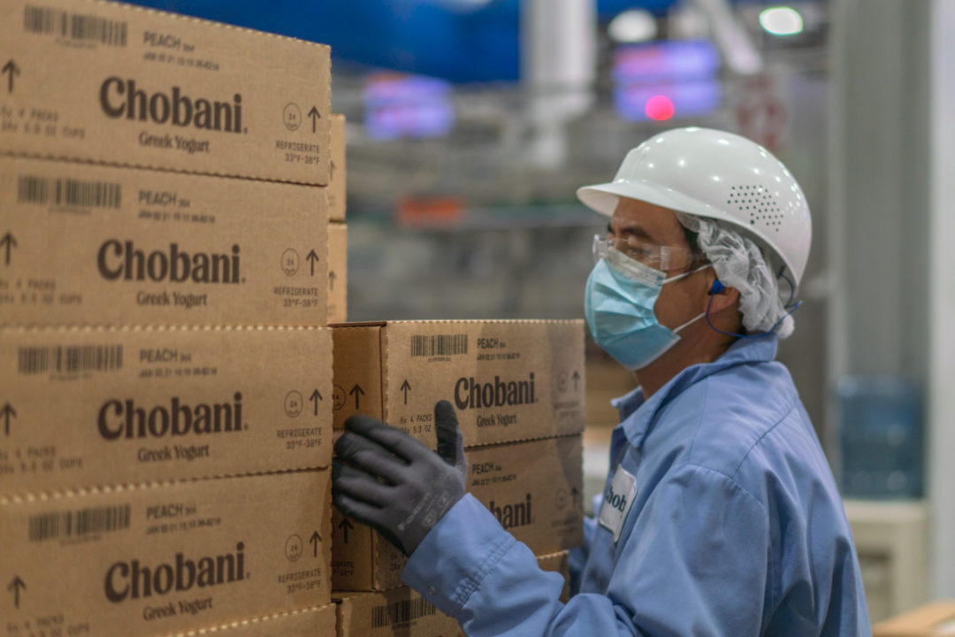 Chobani employee with Chobani boxes