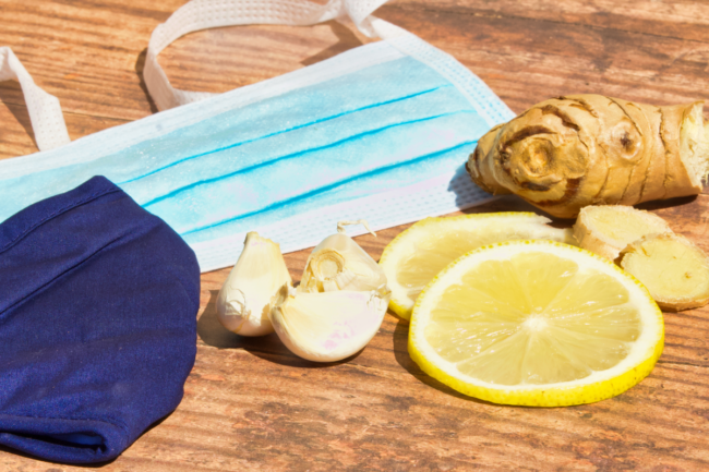 Immunue-boosting ingredients on a table next to face masks