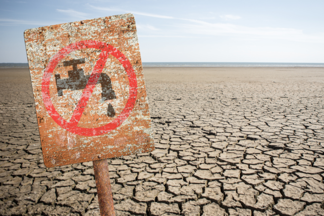 No fresh water sign in dry cracked earth