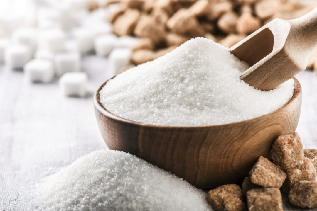 Bowl and scoop of sugar