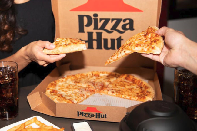 Pizza Hut pizza, wings and fries