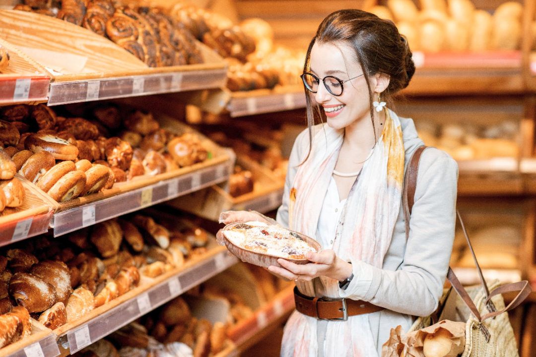 Woman buying pie