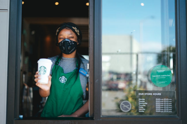 Starbucks drive-thru worker wearing mask for COVID-19