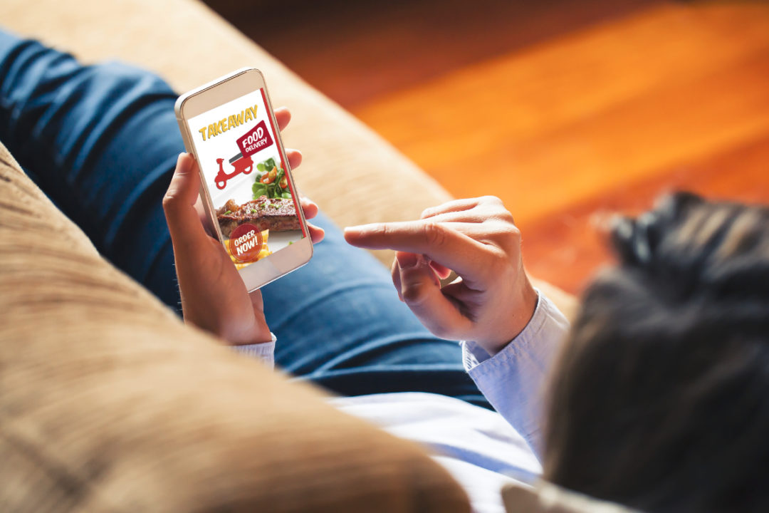 Mobile ordering restaurant delivery from couch
