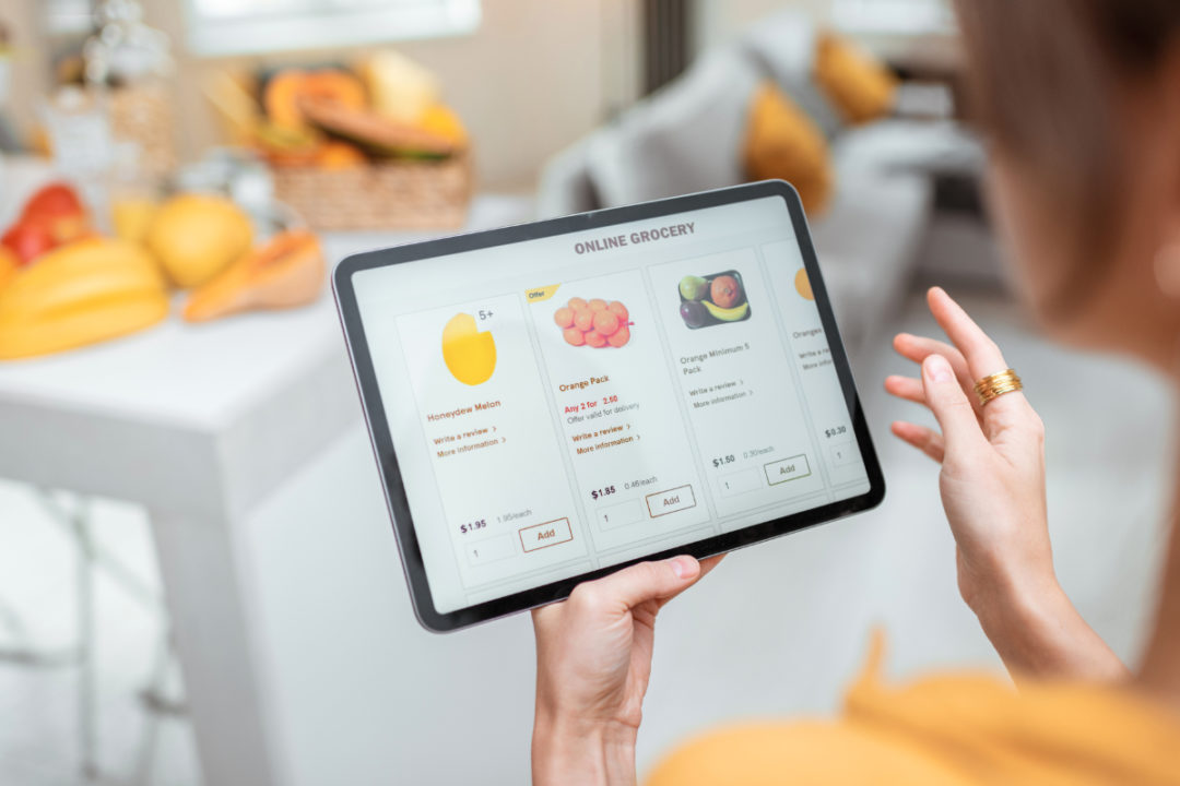 Woman shopping for groceries online via tablet
