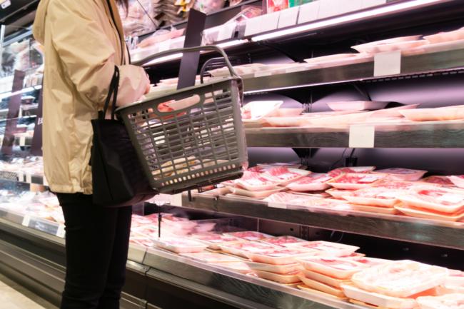 Grocery shopper in meat aisle