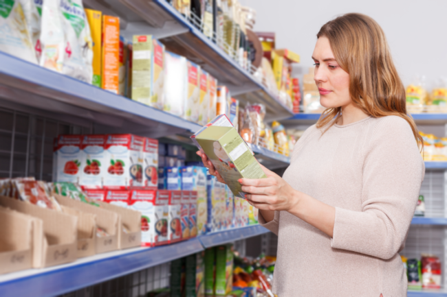 Grocery shopper examining label of cereal box