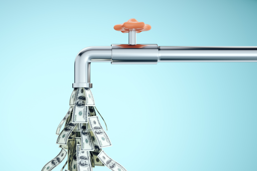 faucet with dollar bills coming out of tap