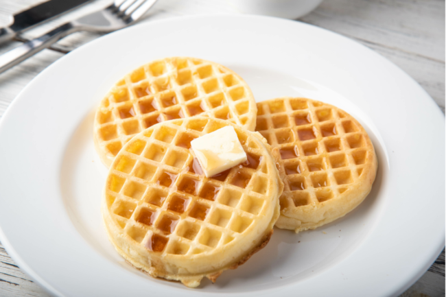 waffles with butter on white plate