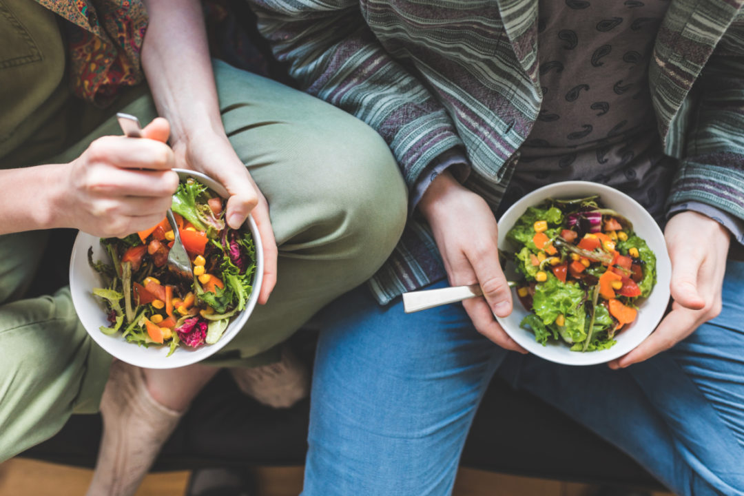 Couple eating salad at home