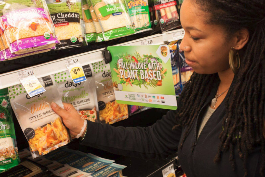 Woman shopping for plant-based dairy alternatives