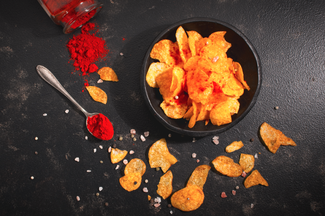 Bowl filled with spicy potato chips