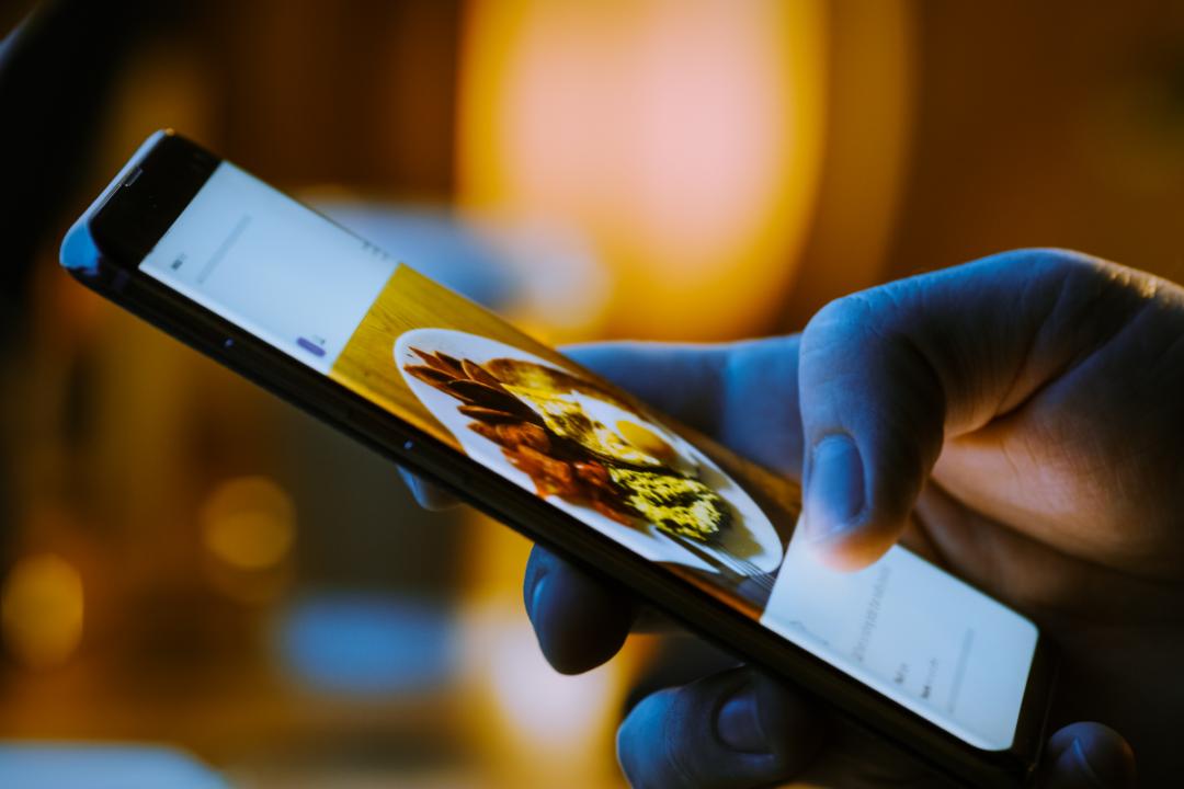 Photo of food on smartphone social media app