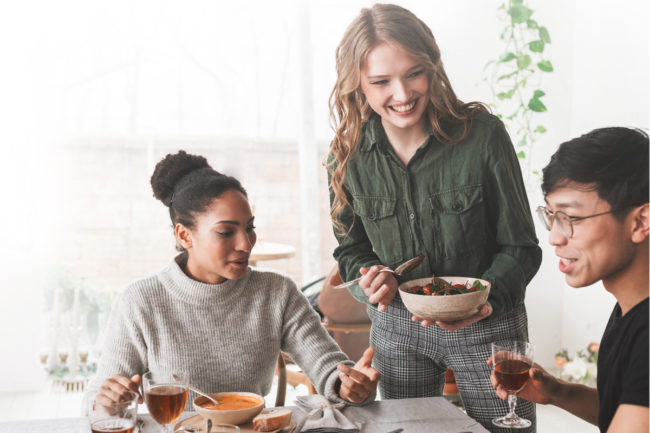 Friends sharing a sustainably sourced meal