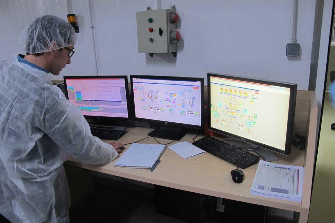 Man looking at multiple desktop monitors