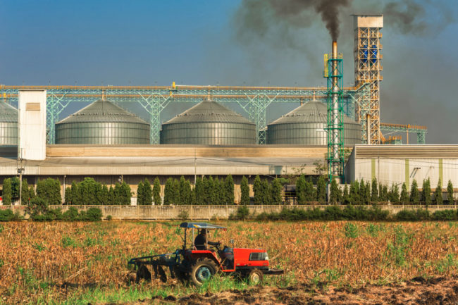 Agricultural silos with thick smoke from pipe emissions
