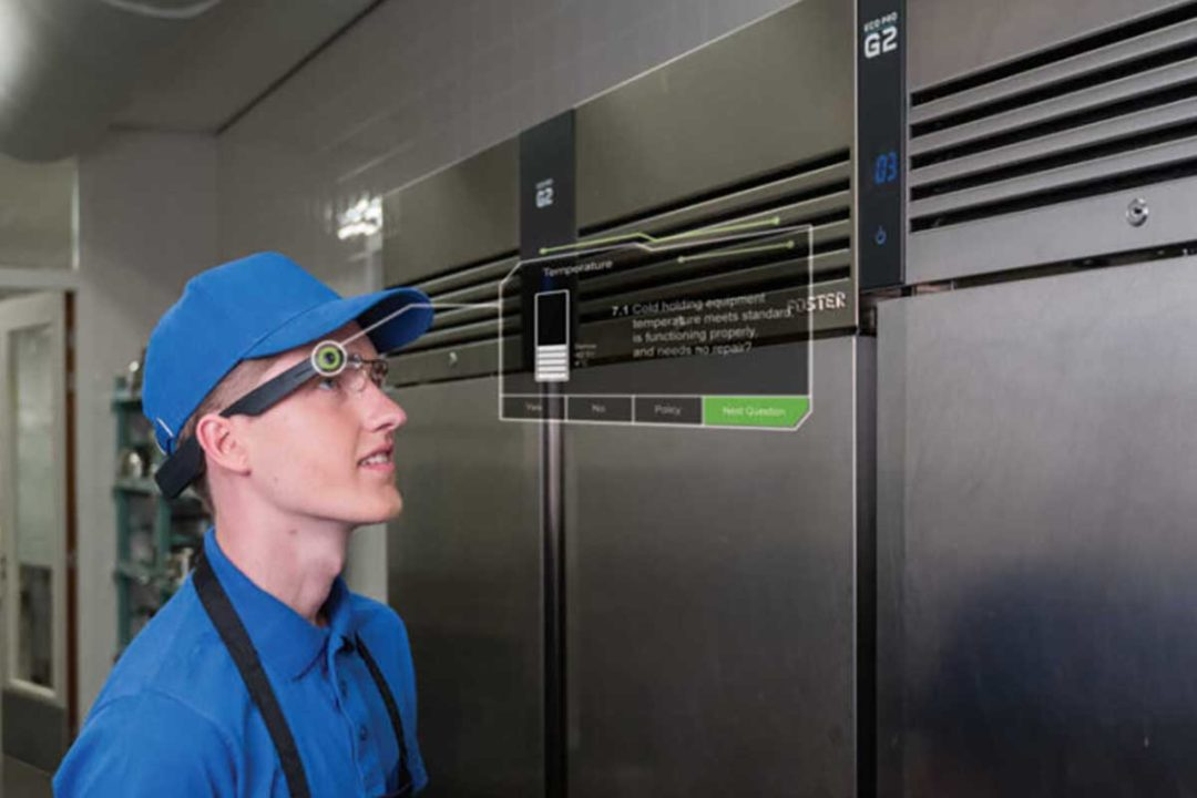 Worker conducting inspection using smart glasses