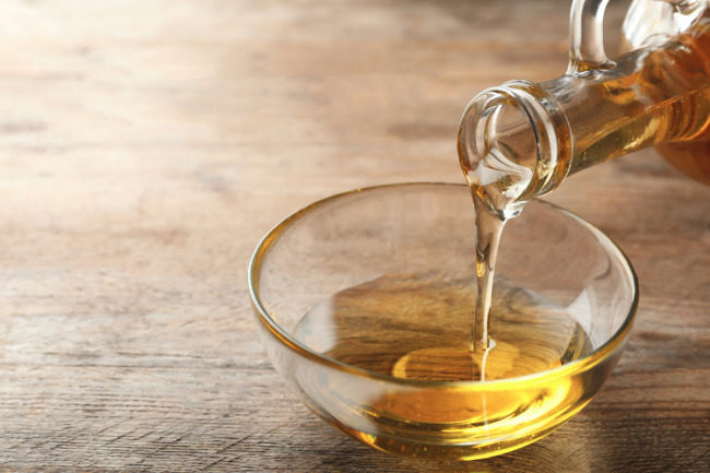 Soybean oil pouring into a bowl