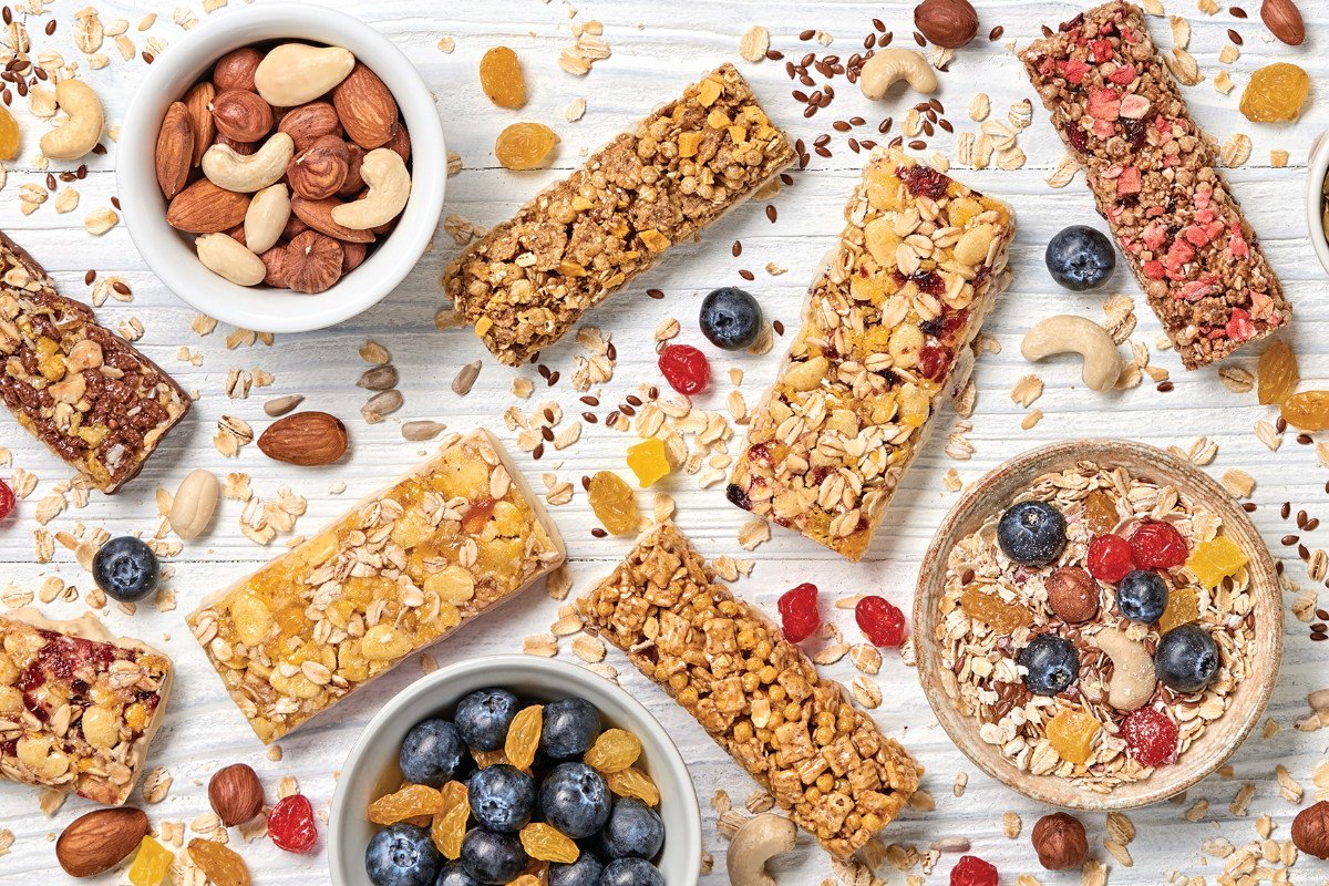 snack bars and healthy snack ingredients on white background