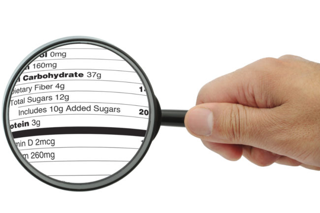 Added sugars label under magnifying glass