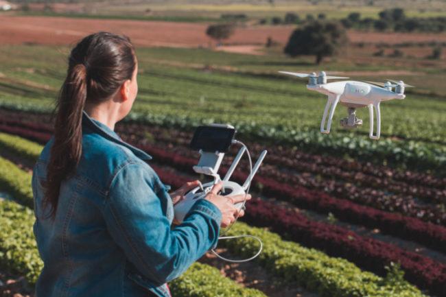 Farmer driving AI agriculture drone